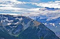 Mount Rainier. Scenic view of snow capped summit of Mount Rainer with blue sky and cloudscape background., Washington, U.S.A Stock Photo