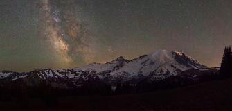 Mount Rainier Panorama under the Milky Way Galaxy. Beautiful starry sky and milky way galaxy behind Mount Rainier in Washington State Stock Photos