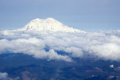 Mount Rainier surrounded by clouds stock image