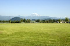 Mount Rainier Towers over Soccer Field Stock Photography