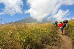 Mount rinjani porter Stock Photography