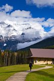 Mount Robson. A female tourist walks up the path to the tourist center at Mount Robson, British Columbia stock photography