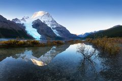 Mount Robson is the most prominent mountain in North America Rocky Mountain range; it is also the highest point. Mount Robson is the most prominent mountain in stock photo