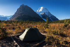 Mount Robson is the most prominent mountain in North America Rocky Mountain range it is also the highest point. Tent in camp. Mount Robson is the most prominent stock photo