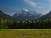Mount Robson Summer Day. The highest mountain in the Canadian Rockies, Mount Robson is usually covered with clouds Stock Image