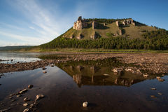 Mount with rocks and reflections in the river. Stock Photos