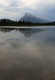Mount Rundle in the Background. Mount Rundle and one of the Vermilion lakes in the foreground.  Located in Banff National Park, Alberta, Canada Stock Photo