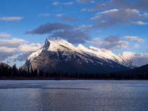 Mount Rundle, Banff Alberta. Mount Rundle reflected in the icy waters of Vermilion Lakes near Banff Alberta Canada at sunset Stock Images