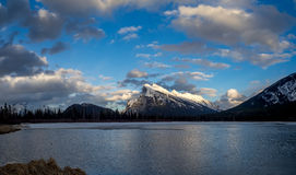 Mount Rundle, Banff Alberta. Mount Rundle reflected in the icy waters of Vermilion Lakes near Banff Alberta Canada at sunset Stock Photography