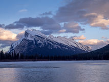 Mount Rundle, Banff Alberta. Mount Rundle reflected in the icy waters of Vermilion Lakes near Banff Alberta Canada at sunset Royalty Free Stock Image