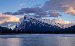 Mount Rundle, Banff Alberta. Mount Rundle reflected in the icy waters of Vermilion Lakes near Banff Alberta Canada at sunset Stock Image