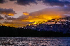 Mount Rundle in early morning light. Sunrise at Two Jacks Lake Stock Images