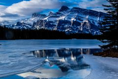 Mount Rundle reflected in Two Jack Lakes. Early spring in banff National Park Royalty Free Stock Photos