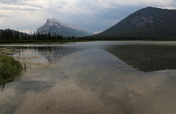 Mount Rundle Reflection. Mount Rundle and one of the Vermilion lakes in the foreground.  Located in Banff National Park, Alberta, Canada Stock Image