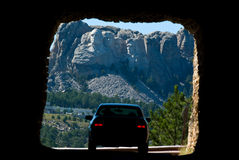 Mount Rushmore. Framed by a tunnel as tourist on a road trip go by Stock Photos