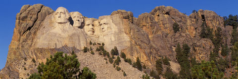 Mount Rushmore. View of Mount Rushmore National Monument against a blue sky. It shows the four faces of George Washington, Thomas Jefferson, Theodore Roosevelt royalty free stock photography