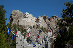 Mount Rushmore Avenue of Flags. The Avenue of Flags with Mount Rushmore in the background stock image