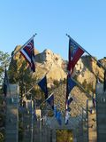 Mount Rushmore with flags. Royalty Free Stock Photos