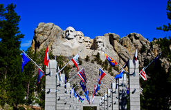 Mount Rushmore with flags Stock Photo