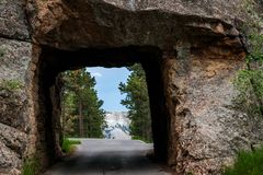 Mount Rushmore framed by tunnel in the Black Hills of South Dakota, USA. Mount Rushmore framed by tunnel on Iron Mountain Road in the Black Hills of South Dakota stock images