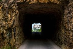 Mount Rushmore framed by tunnel on Iron Mountain Road in the Black Hills of South Dakota, USA. Mount Rushmore framed by Robinson tunnel on Iron Mountain Road in royalty free stock photos