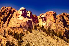 Mount Rushmore front view , expressive edition , purple sky , golden mount stock images