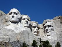 Mount Rushmore. Historic Mount Rushmore. with uniform blue sky background Stock Photos