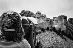 Mount Rushmore. Little girl viewing Mount Rushmore through a vewfinder Stock Photos