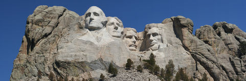 Mount Rushmore Memorial. The faces of Presidents Washington, Jefferson, Roosevelt, and Lincoln protrude from a granite mountain Stock Photos