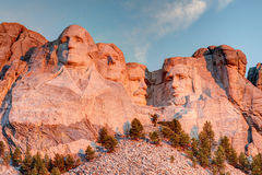 Mount Rushmore National Memorial. Scenic Mount Rushmore National Memorial landscape in America on a clear blue sunny morning during sunrise showing all four Royalty Free Stock Photo