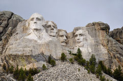 Mount Rushmore with neutral sky. Mount Rushmore in color with neutral blue sky stock photo