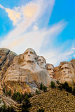 Mount Rushmore sunset colors. Mount Rushmore depicting the founding fathers of the United States, in South Dakota nearing sunset royalty free stock photo