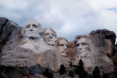 Mount Rushmore Under Blue Clouds. South Dakota tourist attraction. The four president faces carved into stone mountain called Mount Rushmore. Washington stock images