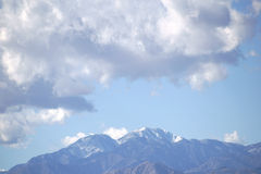 Mount San Jacinto. The snowcapped peak of Mount San Jacinto in the San Jacinto Mountains with clouds over the mountains Stock Photos