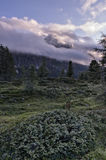 Mount Sass de Stria at sunrise, blue sky with clouds and fog, Falzarego pass, Dolomites, Veneto, Italy Royalty Free Stock Photos