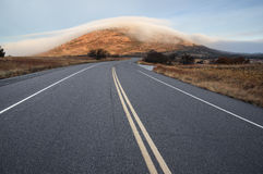 Mount Scott In Fog. Highway 49 leads towards Mount Scott covered in fog in the Wichita Wildlife Refuge Stock Photos