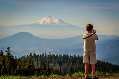Mount Shasta. A budding young photographer taking a picture of Mount Shasta in the distance royalty free stock image