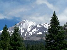 Mount Shasta in Clouds. Mount Shasta, exhibiting fresh snow in July Stock Photo