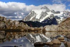 Mount Shuksan with reflection Stock Photos