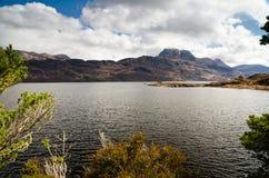 Mount Slioch framed above Loch Maree Stock Photo