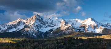 Mount Sneffels in an early morning Autumn in south western Colorado. Mount Sneffels is within the Uncompahgre National Forest. An early fall snowstorm covers stock photography