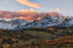 Mount Sneffels at Sunrise. Mount Sneffels is the highest summit of the Sneffels Range in the Rocky Mountains of North America. The prominent 14,158-foot 4315.4 m stock images