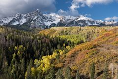 Mount Sneffels Mountain Range located in Southwestern Colorado. Mount Sneffels Mountain Range with a fresh early autumn snow. Aspen, Pine and Scrub Oak add to royalty free stock photography