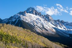 Mount Sneffels in the late afternoon autumn light in south western Colorado. Mount Sneffels is within the Uncompahgre National Forest. An early fall snowstorm stock photos