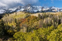 Mount Sneffels Mountain Range located in Southwestern Colorado. Mount Sneffels is within the Uncompahgre National Forest. An early fall snowstorm covers the stock image