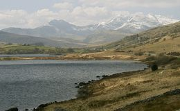 Mount Snowdon. With lake in the foreground, Snowdonia National Park, Wales, UK stock photography