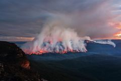 Mount Solitary bush fire burning at dusk royalty free stock image