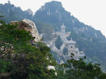 Mount Songshan fault and buildings. A man sitting on Mount Songshan fault geological structureinside near few pagodas inside Shaolin Temple dengfeng city henan Stock Photography