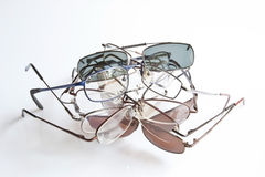 Mount Spectacular. Several pairs of glasses stacked against a white background Royalty Free Stock Photos
