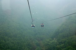 Mount taishan cable car  in the misty rain Stock Images